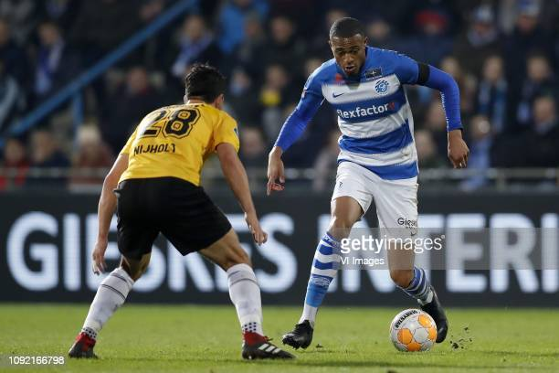 Gianluca Nijholt of NAC Breda Delano Burgzorg of De Graafschap during the Dutch Eredivisie match between De Graafschap Doetinchem and NAC Breda at De...