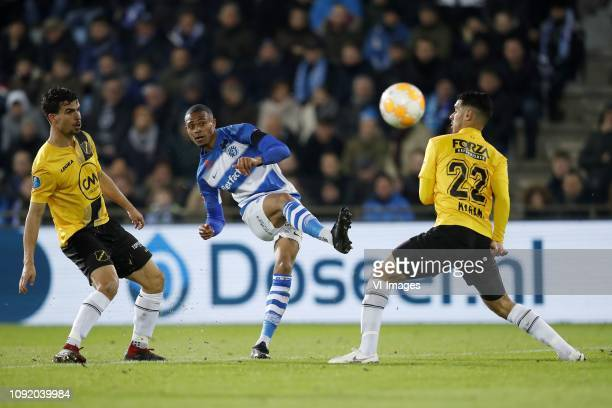 Gianluca Nijholt of NAC Breda Delano Burgzorg of De Graafschap Khalid Karami of NAC Breda during the Dutch Eredivisie match between De Graafschap...