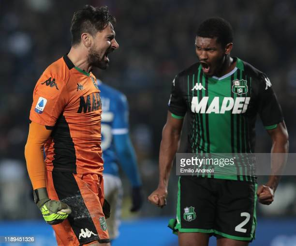 Gianluca Pegolo of US Sassuolo celebrates with his team-mate Marlon after making a save during the Serie A match between Brescia Calcio and US...
