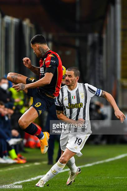 Gianluca Scamacca of Genoa and Leonardo Bonucci of Juventus vie for the ball during the Serie A match between Genoa CFC and Juventus Fc at Stadio...