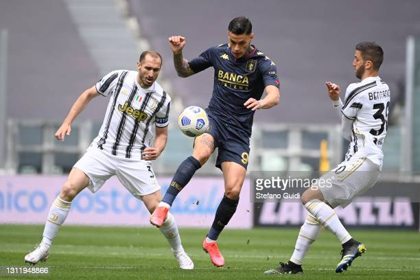 Gianluca Scamacca of Genoa CFC against Rodrigo Bentancur of Juventus FC during the Serie A match between Juventus and Genoa CFC at Allianz Stadium on...