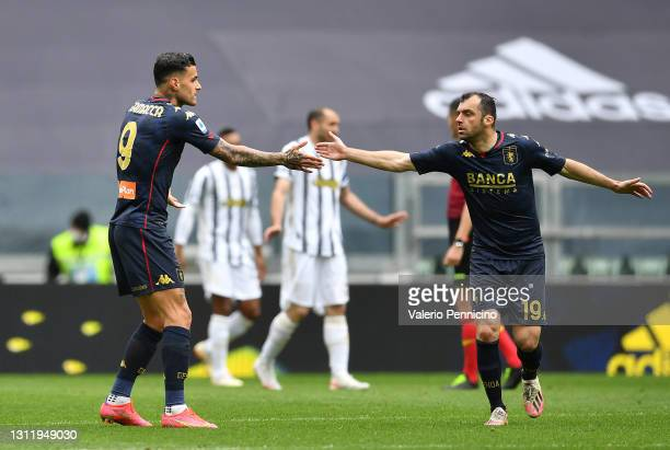 Gianluca Scamacca of Genoa C.F.C. Celebrates with Goran Pandev after scoring their side's first goal during the Serie A match between Juventus and...