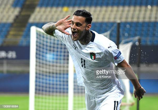 Gianluca Scamacca of Italy celebrates scoring his team's first goal during the 2021 UEFA European Under-21 Championship Group B match between Czech...