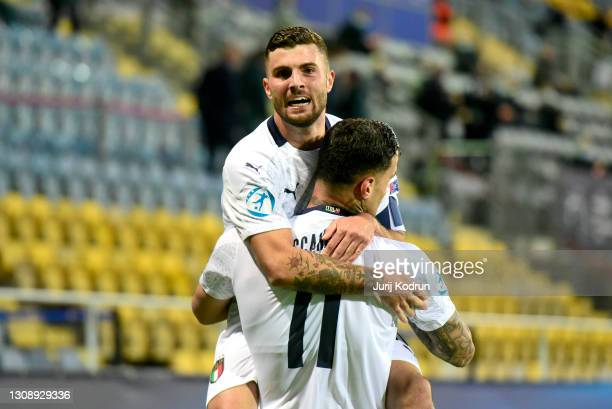 Gianluca Scamacca of Italy celebrates scoring his team's first goal with teammate Patrick Cutrone during the 2021 UEFA European Under-21 Championship...