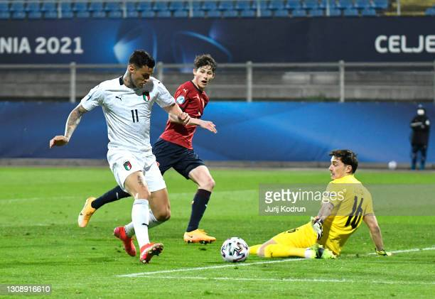 Gianluca Scamacca of Italy scores his team's first goal during the 2021 UEFA European Under-21 Championship Group B match between Czech Republic and...
