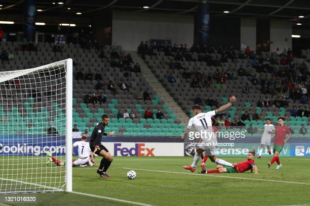 Gianluca Scamacca of Italy scores to reduce the arrears to 3-2 during the 2021 UEFA European Under-21 Championship Quarter-finals match between...