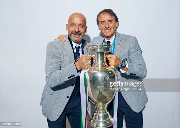 Gianluca Vialli, Delegation Chief of Italy and Roberto Mancini, Head Coach of Italy pose with The Henri Delaunay Trophy during an Italy Portrait...