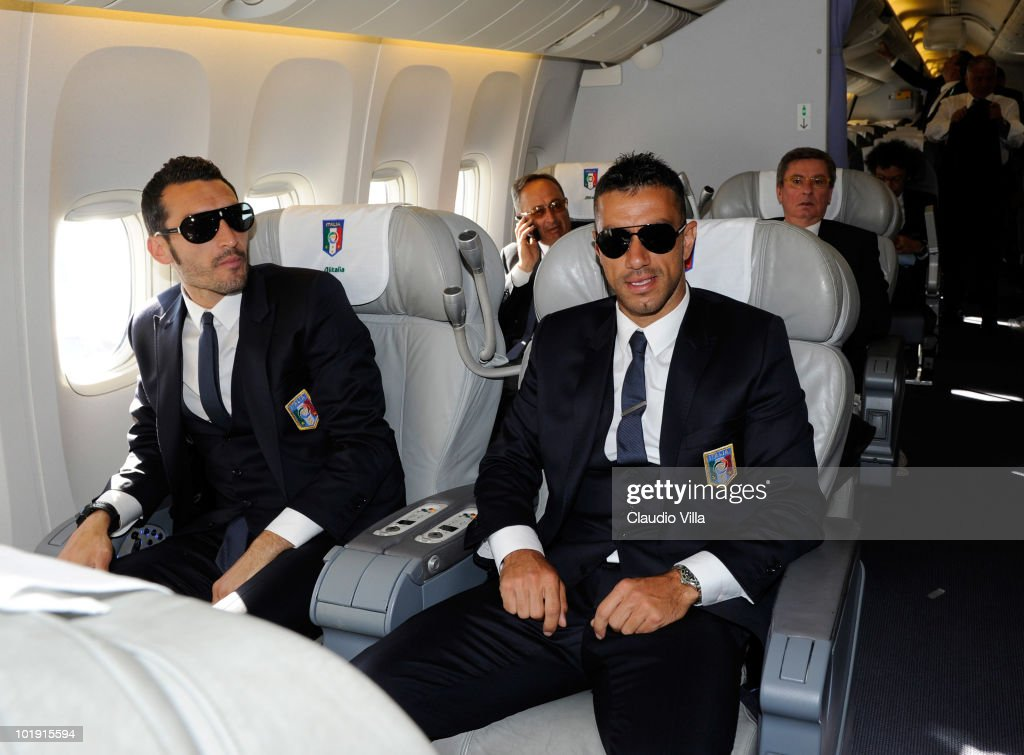 Gianluca Zambrotta and Fabio Quagliarella of Italy sit on a plane during their arrival for the 2010 FIFA World Cup at O.R. Tambo International Airport on June 9, 2010 in Johannesburg, South Africa.