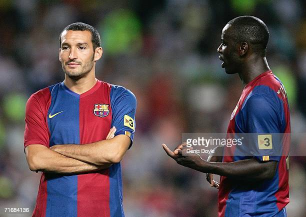 Gianluca Zambrotta and Lilian Thuram of Barcelona chat at the end of their Supercup 2nd leg match against Espanyol at the Camp Nou stadium on August...