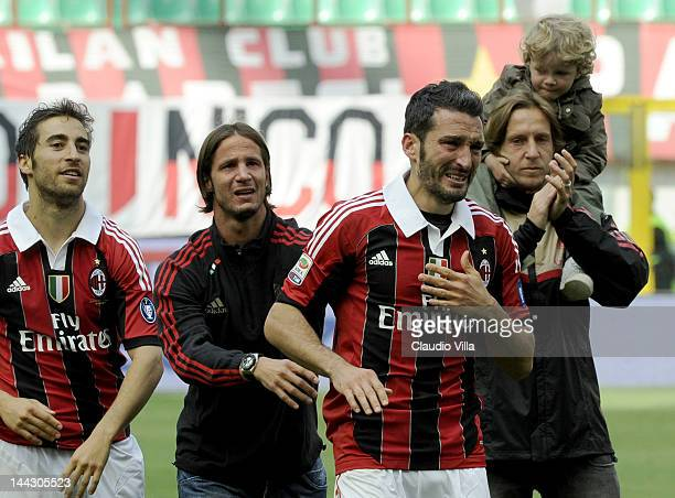 Gianluca Zambrotta of AC Milan salutes the fans after his last game for AC Milan after the Serie A match between AC Milan and Novara Calcio at Stadio...