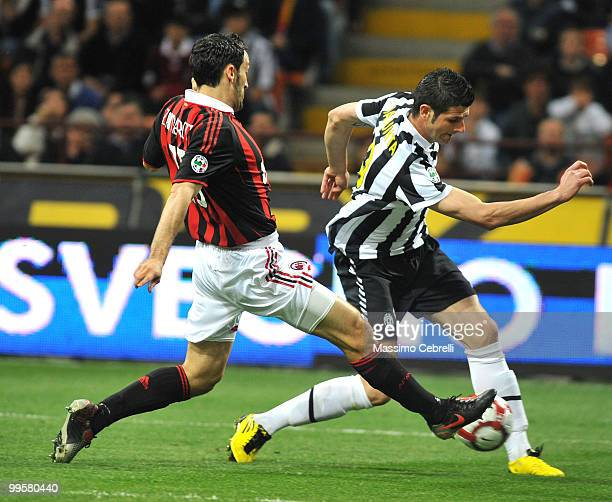 Gianluca Zambrotta of AC Milan tackles Vincenzo Iaquinta of Juventus FC during the Serie A match between AC Milan and Juventus FC at Stadio Giuseppe...