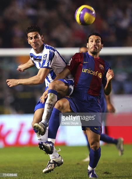 Gianluca Zambrotta of Barcelona goes for a high ball against Riki of Deportivo during a Primera Liga match between Deportivo La Coruna and Barcelona...
