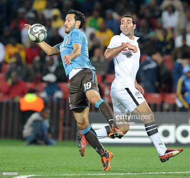 Gianluca Zambrotta of Italy and Mohamed Aboutrika of Egypt battle during the 2009 Confederations Cup match between Egypt and Italy at CocaCola...