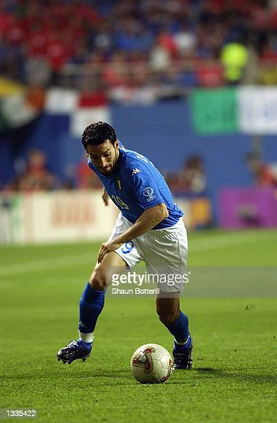 Gianluca Zambrotta of Italy runs with the ball during the South Korea v Italy World Cup Second Round match played at the Daejeon World Cup Stadium in...