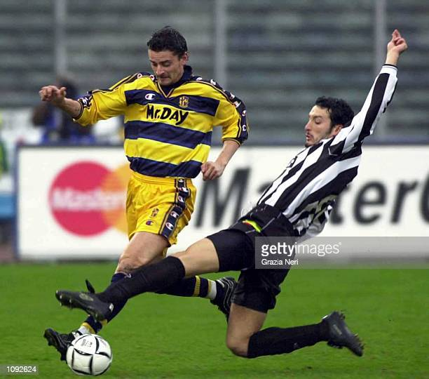 Gianluca Zambrotta of Juventus and Luigi Sartor of Parma in action during the Serie A 10th Round League match between Juventus and Parma played at...
