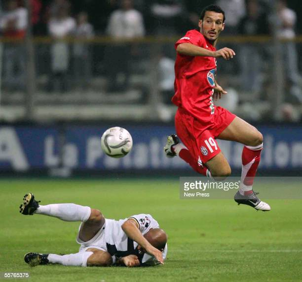 Gianluca Zambrotta of Juventus jumps for the ball during the Serie A match between Parma and Juventus at the Ennio Tardini Stadium on September 24,...