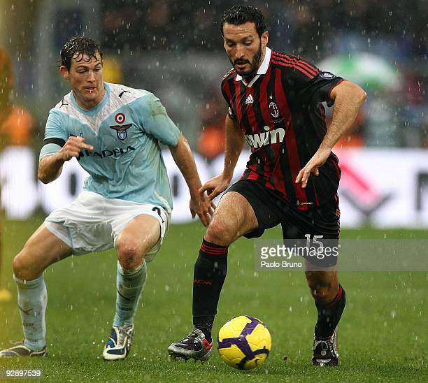 Gianluca Zambrotta of Milan and Stephan Leichtsteiner of SS Lazio in action during the Serie A match between SS Lazio and AC Milan at Stadio Olimpico...