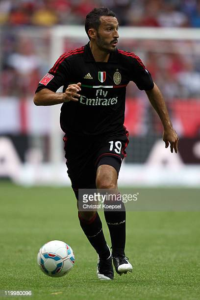 Gianluca Zambrotta of Milan runs with the ball during the Audi Cup third place match between AC Milan and International De Porto Alegre at Allianz...