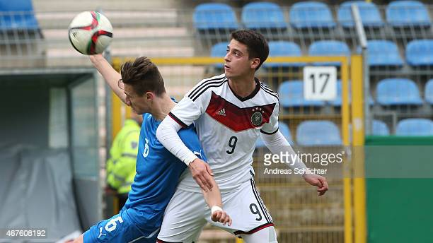 Gianlucca Rizzo of Germany challenges Dominik Kruzliak of Slovakia during the UEFA Under19 Elite Round match between U19 Germany and U19 Slovakia at...