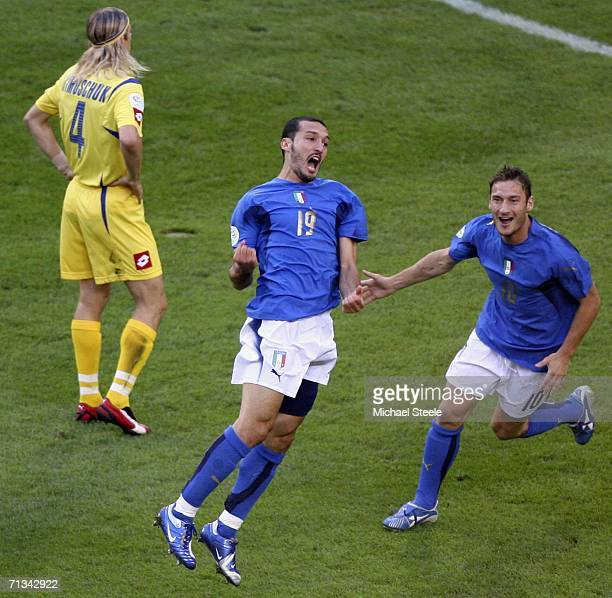 Gianluci Zambrotta of Italy celebrates after scoring the opening goal during the FIFA World Cup Germany 2006 Quarterfinal match between Italy and...