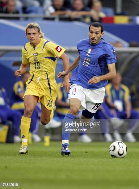 Gianluci Zambrotta of Italy is pursued by Maksym Kalinichenko of the Ukraine during the FIFA World Cup Germany 2006 Quarter-final match between Italy...