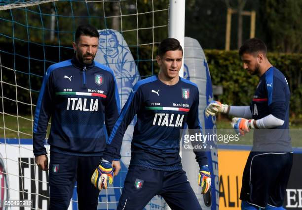 Gianluigi Buffon Alex Meret and Gianluigi Donnarumma of Italy look on during the training session at the club's training ground at Coverciano on...
