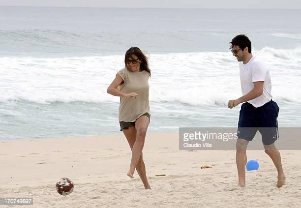 Gianluigi Buffon and Alena Seredova play with a football at the Barra de Tijuca beach on June 17 2013 in Rio de Janeiro Brazil