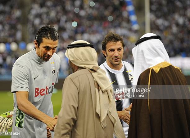 Gianluigi Buffon and Alessandro Del Piero of Juventus shake hands with unidentified Saudi managers of al-Hilal club during the farewell match of...