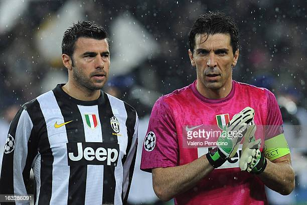 Gianluigi Buffon and Andrea Barzagli of Juventus look on prior to the UEFA Champions League round of 16 second leg match between Juventus and Celtic...