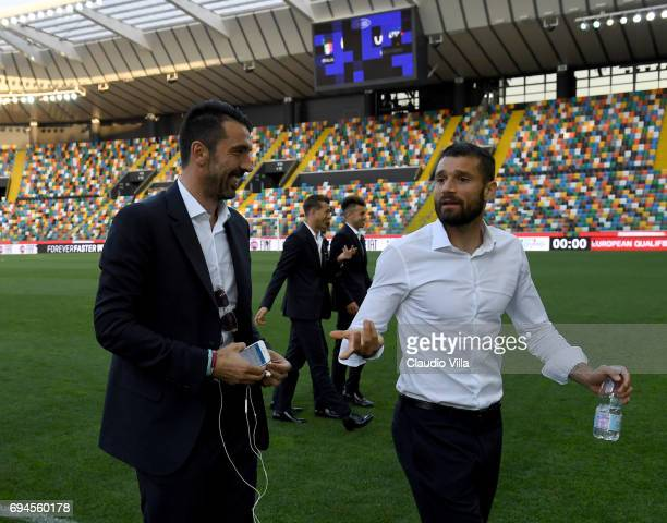 Gianluigi Buffon and Antonio Candreva of Italy chat during Italy walk around at Stadio Friuli on June 10 2017 in Udine Italy