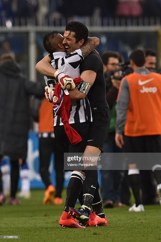 Gianluigi Buffon and Arturo Vidal of Juventus FC celebrate after beating UC Sampdoria 1-0 to win the Serie A Championships at the end of the Serie A match between UC Sampdoria and Juventus FC at Stadio Luigi Ferraris on May 2, 2015 in Genoa, Italy.