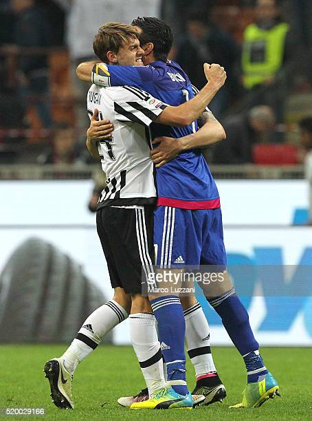 Gianluigi Buffon and Daniele Rugani of Juventus FC celebrates a victory at the end of the Serie A match between AC Milan and Juventus FC at Stadio...