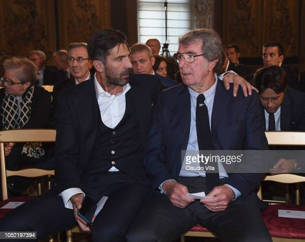 Gianluigi Buffon and Dino Zoff chat during Italy Team meets President Sergio Mattarella on October 15 2018 in Rome Italy