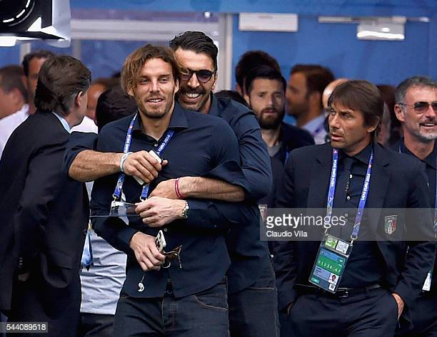 Gianluigi Buffon and Federico Marchetti joke during Italy pitch walkabout ahead of tomorrow's UEFA Euro 2016 quarter final match against Germany at...