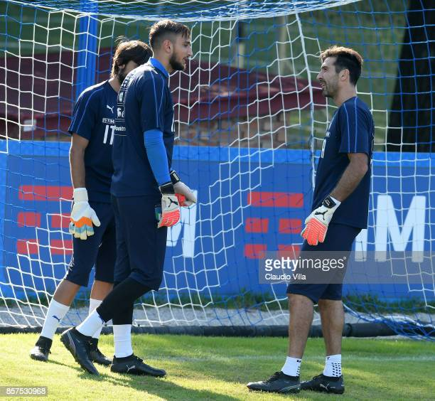 Gianluigi Buffon and Gianluigi Donnarumma of Italy chat during a training session at Italy club's training ground at Coverciano on October 4 2017 in...