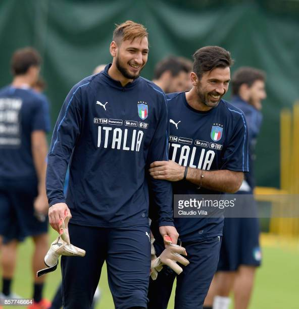 Gianluigi Buffon and Gianluigi Donnarumma of Italy chat during a training session at Italy club's training ground at Coverciano on October 5 2017 in...