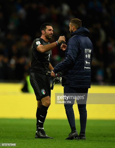Gianluigi Buffon and Gianluigi Donnarumma of Italy dejected at the end of the FIFA 2018 World Cup Qualifier PlayOff Second Leg between Italy and...
