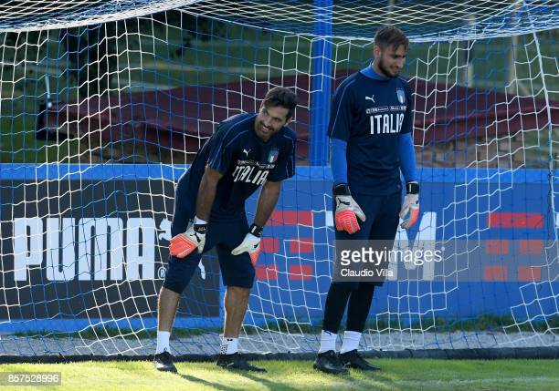 Gianluigi Buffon and Gianluigi Donnarumma of Italy look on during a training session at Italy club's training ground at Coverciano on October 4 2017...