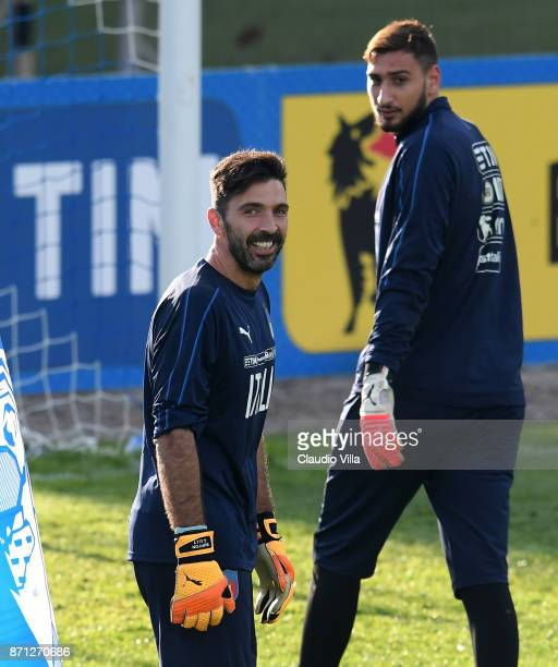 Gianluigi Buffon and Gianluigi Donnarumma of Italy look on during a training session at Italy club's training ground at Coverciano on November 7 2017...