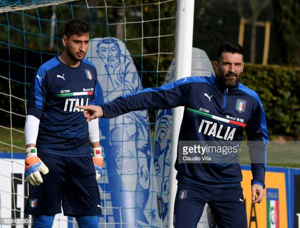 Gianluigi Buffon and Gianluigi Donnarumma of Italy look on during the training session at the club's training ground at Coverciano on March 22 2017...