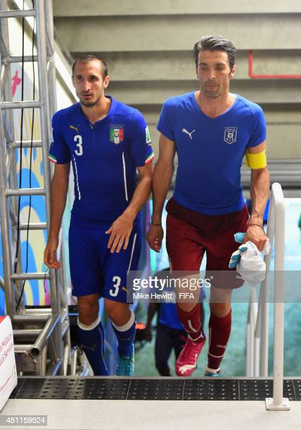 Gianluigi Buffon and Giorgio Chiellini of Italy walk in the tunnel after the 01 defeat in the 2014 FIFA World Cup Brazil Group D match between Italy...