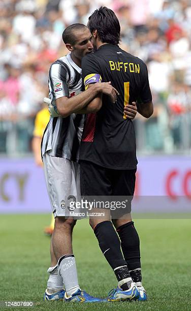 Gianluigi Buffon and Giorgio Chiellini of Juventus FC celebrate victory at the end of the Serie A match between Juventus FC v Parma FC at Juventus...