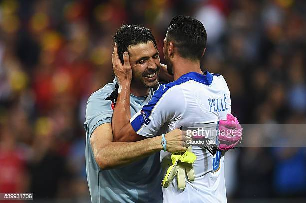 Gianluigi Buffon and Graziano Pelle of Italy ccelebrate their 20 win after the UEFA EURO 2016 Group E match between Belgium and Italy at Stade des...