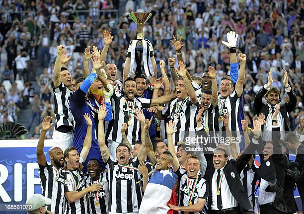 Gianluigi Buffon and Juventus FC and teammates celebrate with the Serie A trophy after the Serie A match between Juventus and Cagliari Calcio at...