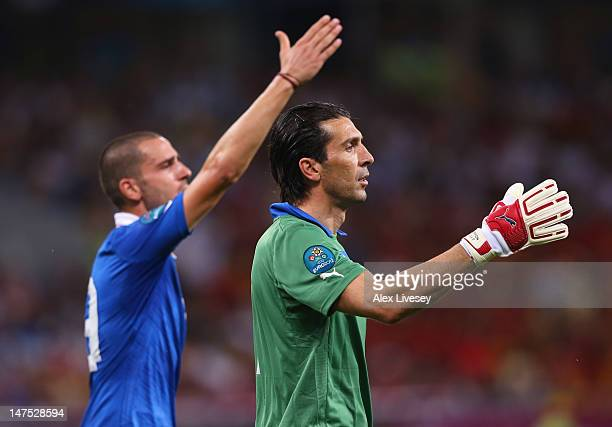 Gianluigi Buffon and Leonardo Bonucci of Italy gesture during the UEFA EURO 2012 final match between Spain and Italy at the Olympic Stadium on July 1...