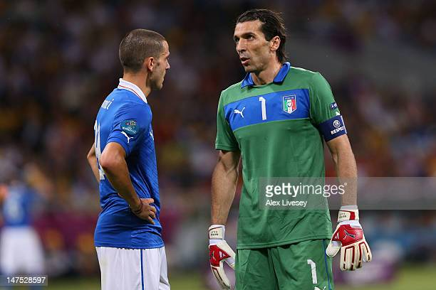 Gianluigi Buffon and Leonardo Bonucci of Italy look on during the UEFA EURO 2012 final match between Spain and Italy at the Olympic Stadium on July 1...