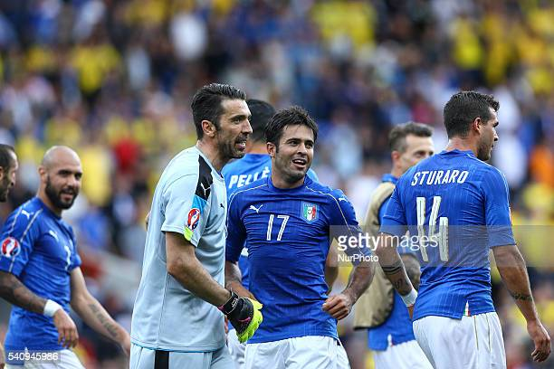 Gianluigi Buffon and Martins Eder of Italy celebrate the victory after the UEFA EURO 2016 Group E match between Italy and Sweden at Stadium Municipal...