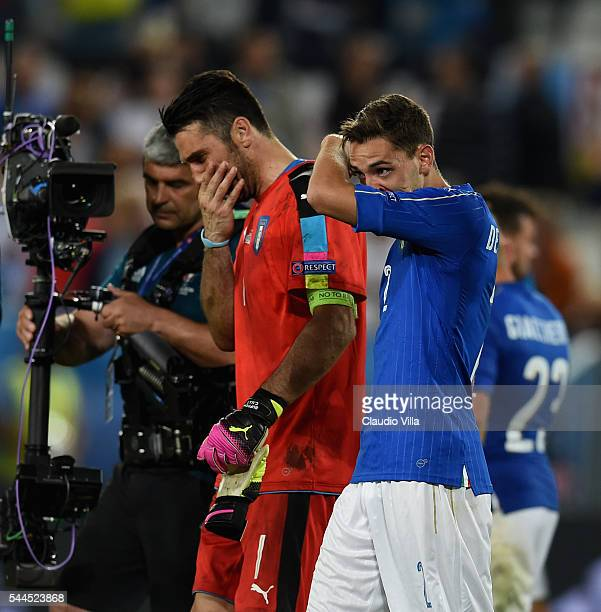 Gianluigi Buffon and Mattia De Sciglio of Italy cry at the end of the UEFA Euro 2016 quarter final match between Germany and Italy at Stade Matmut...