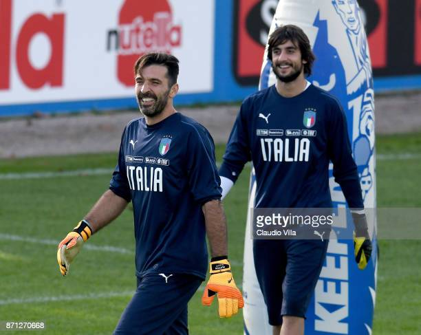 Gianluigi Buffon and Mattia Perin of Italy look on during a training session at Italy club's training ground at Coverciano on November 7 2017 in...