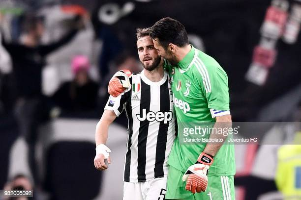 Gianluigi Buffon and Miralem Pjanic of Juventus celebrate the victory at the end of the serie A match between Juventus and Atalanta BC on March 14...